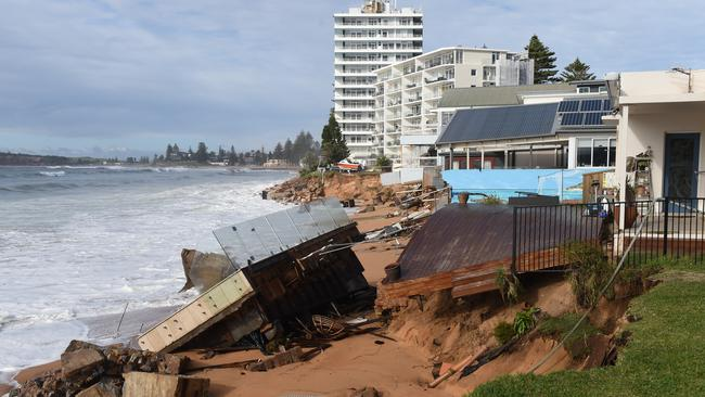 Beachfront homes along Pittwater Road at Collaroy suffered more damage overnight, as the land was eaten away by huge seas. Picture: Dean Lewins / AAP