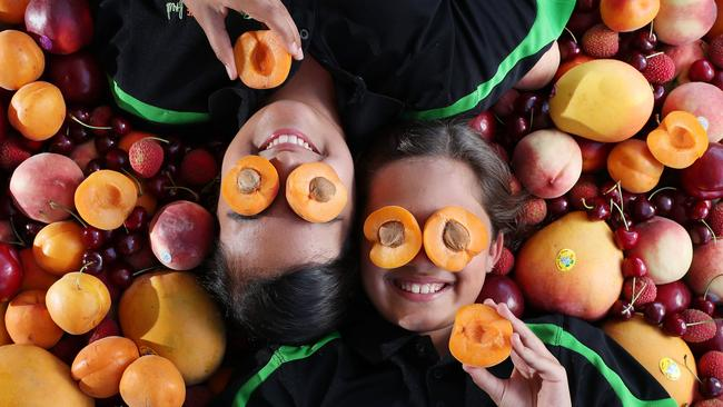 Betty and Sophia Angeli, 12, of Ashgrove, love stone fruit season. Picture: Liam Kidston