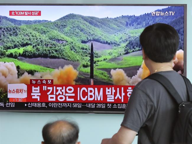 People watch local TV news showing what was said to be the launch of a Hwasong-14 intercontinental ballistic missile by North Korea. Picture: AP