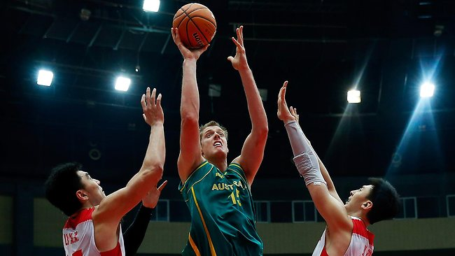 Boomer Luke Nevill drives to the basket against Li Xiaoxu (L) and Ji Zhe (R) of China during game three of the series between the Australian Boomers and China at Tianjin Sports Centre.