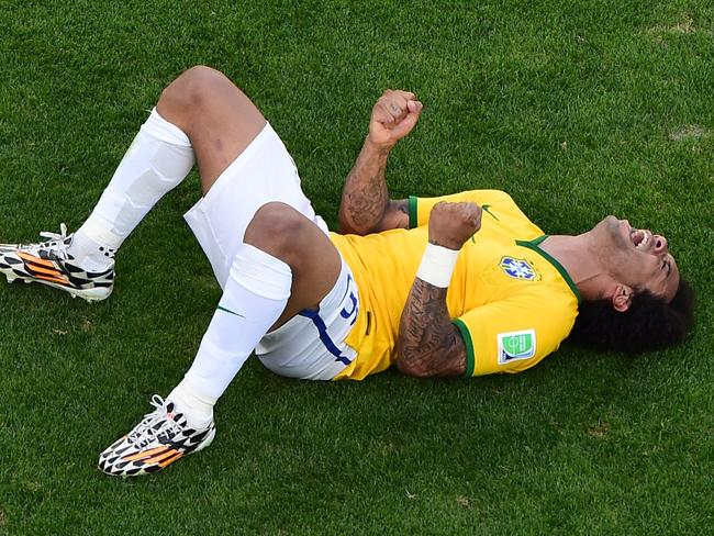 Brazil's defender Marcelo celebrates at the end of the penalty shootout after his side defeated Chile in the World Cup 2014 round of 16.