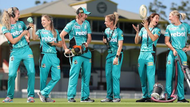 Brisbane Heat women's players Holly Ferling (radio news reporter), Jemma Barsby (barista), Sammy-Jo Johnson (landscaper), Kirby Short and Courtney Hill (teachers) and Delissa Kimmince (cleaning business). Picture: Peter Wallis