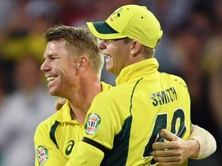 David Warner (left) of Australia is congratulated by Steve Smith after catching out Shoaib Malik of Pakistan during the fourth One Day International between Australia and Pakistan at the Sydney Cricket Ground in Sydney on Sunday, Jan. 22, 2017. (AAP Image/Paul Miller) NO ARCHIVING, EDITORIAL USE ONLY, IMAGES TO BE USED FOR NEWS REPORTING PURPOSES ONLY, NO COMMERCIAL USE WHATSOEVER, NO USE IN BOOKS WITHOUT PRIOR WRITTEN CONSENT FROM AAP