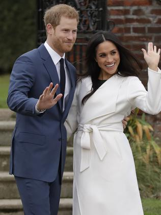 Prince Harry and Meghan Markle waved to the waiting media and fans. Picture: AP Photo/Matt Dunham