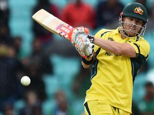 Australia's David Warner plays a shot during the ICC Champions Trophy match between Australia and Bangladesh at The Oval in London on June 5, 2017. / AFP PHOTO / Glyn KIRK / RESTRICTED TO EDITORIAL USE