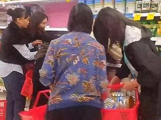 People taking baby formual at Richmond Coles.