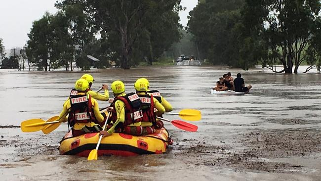Qld Flood People On Top Of Car