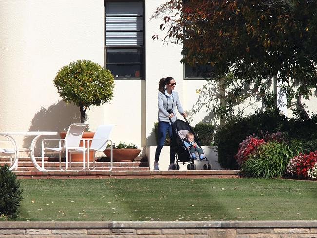 The Duchess of Cambridge takes Prince George for a walk.