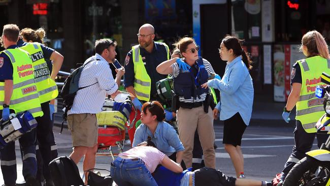 Paramedics treat a number of pedestrians. Picture: Aaron Francis/The Australian