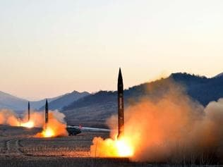 """TOPSHOT - This undated picture released by North Korea's Korean Central News Agency (KCNA) via KNS on March 7, 2017 shows the launch of four ballistic missiles by the Korean People's Army (KPA) during a military drill at an undisclosed location in North Korea. Nuclear-armed North Korea launched four ballistic missiles on March 6 in another challenge to President Donald Trump, with three landing provocatively close to America's ally Japan. / AFP PHOTO / KCNA VIA KNS / STR / South Korea OUT / REPUBLIC OF KOREA OUT ---EDITORS NOTE--- RESTRICTED TO EDITORIAL USE - MANDATORY CREDIT """"AFP PHOTO/KCNA VIA KNS"""" - NO MARKETING NO ADVERTISING CAMPAIGNS - DISTRIBUTED AS A SERVICE TO CLIENTS THIS PICTURE WAS MADE AVAILABLE BY A THIRD PARTY. AFP CAN NOT INDEPENDENTLY VERIFY THE AUTHENTICITY, LOCATION, DATE AND CONTENT OF THIS IMAGE. THIS PHOTO IS DISTRIBUTED EXACTLY AS RECEIVED BY AFP. /"""