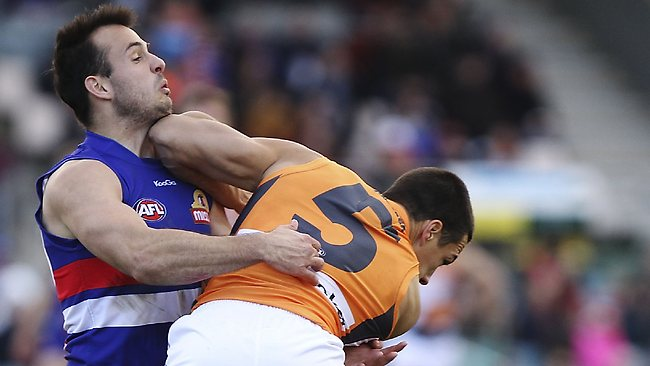 CANBERRA, AUSTRALIA - JULY 06: Tory Dickson of the Bulldogs is hit in the chin by Dylan Shiel of the Giants during the round 15 AFL match between the Greater Western Sydney Giants and the Western Bulldogs at Manuka Oval on July 6, 2013 in Canberra, Australia. (Photo by Stefan Postles/Getty Images)
