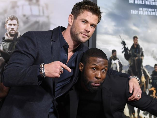Chris Hemsworth and the man whose abs he is jealous of .. Trevante Rhodes. Picture: AFP