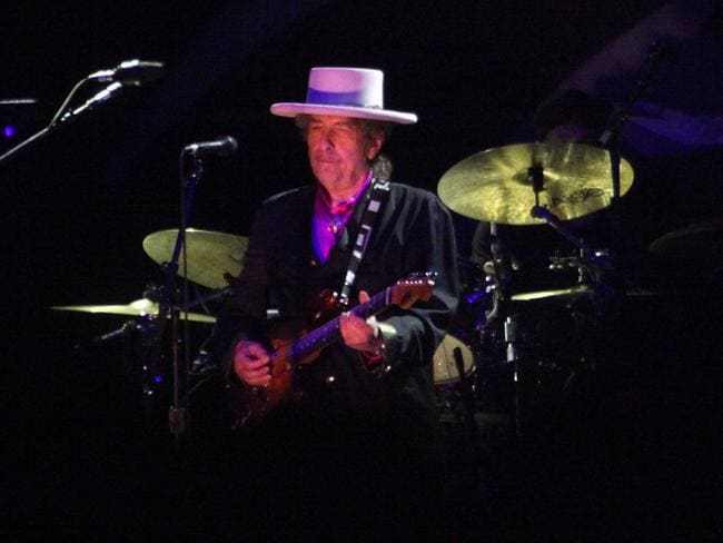 From a previous concert tour ... the guitar is no longer a fixture of Dylan's concerts.
