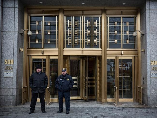 Added security ... guards stand outside New York's Federal Court as the trial for Sulaiman Abu Ghaith begins.