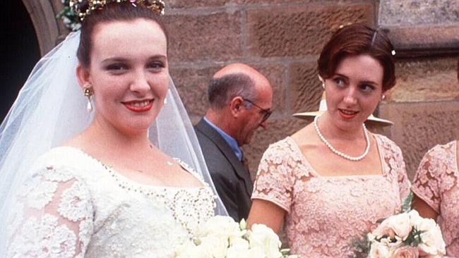 Cheryl gives the side-eye as a bridesmaid at Muriel's - sorry, Mariel's - wedding.