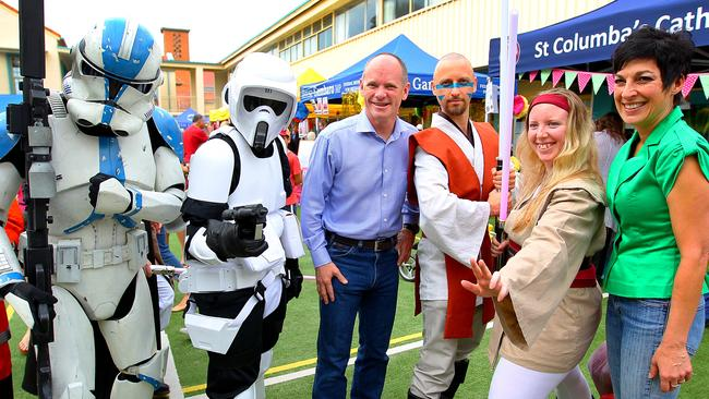Campbell Newman and wife Lisa (green top) enjoyed some fun and games at the St Columbas School fete in Brisbane. Picture: Jack Tran