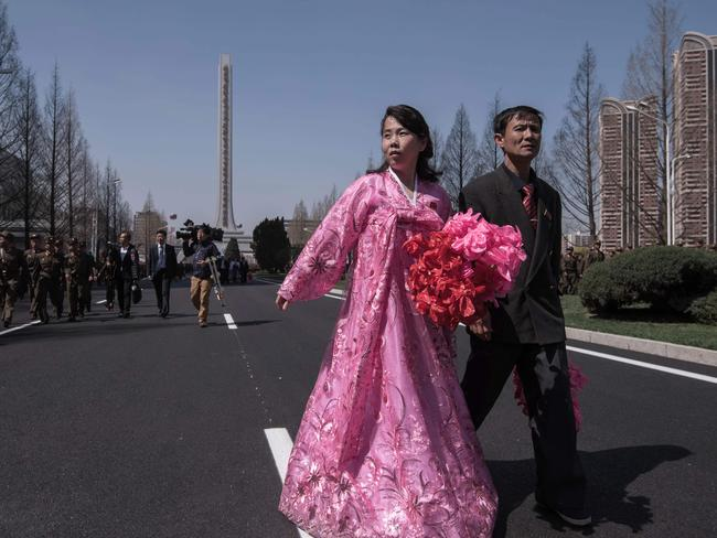 Visitors walk along Ryomyong Street following the opening ceremony. Picture: Ed Jones/AFP