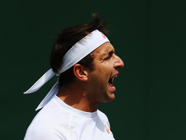 Thriller ... Marinko Matosevic fought hard but lost to Jeremy Chardy in five sets.