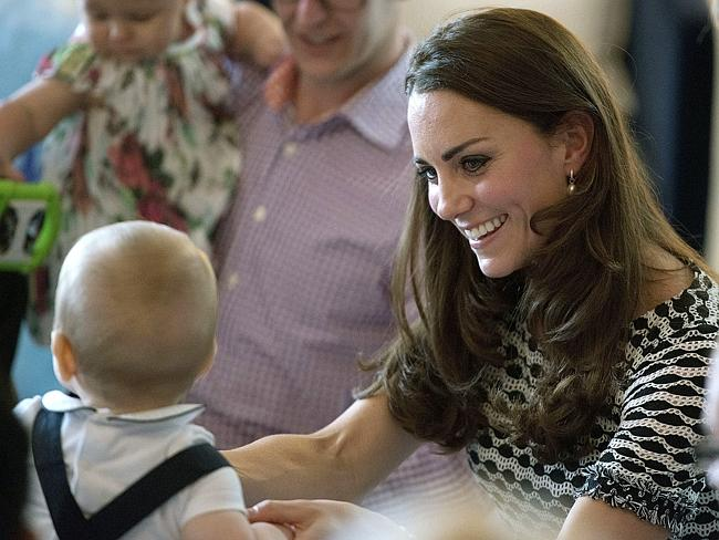 Clucky? Kate, the Duchess of Cambridge, plays with Prince George during a visit to Plunke