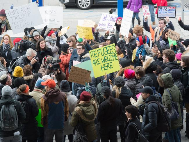Protesters gather at JFK International Airport's Terminal 4 to demonstrate against US President Donald Trump's executive order. Picture: AFP