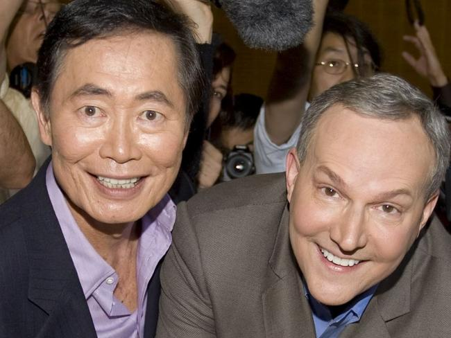 George Takei, left, and his partner Brad Altman sign documents as they get their marriage certificate permit in West Hollywood in 2008. Picture: AP