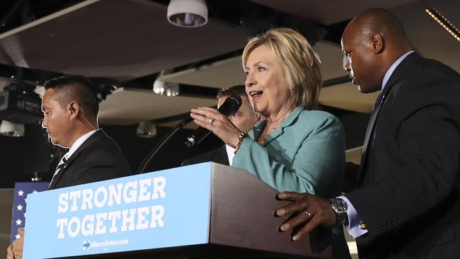 Secret Service agents surround Democratic presidential candidate Hillary Clinton on stage after animal activists disrupted her campaign in Las Vegas on Thursday. Picture: AP