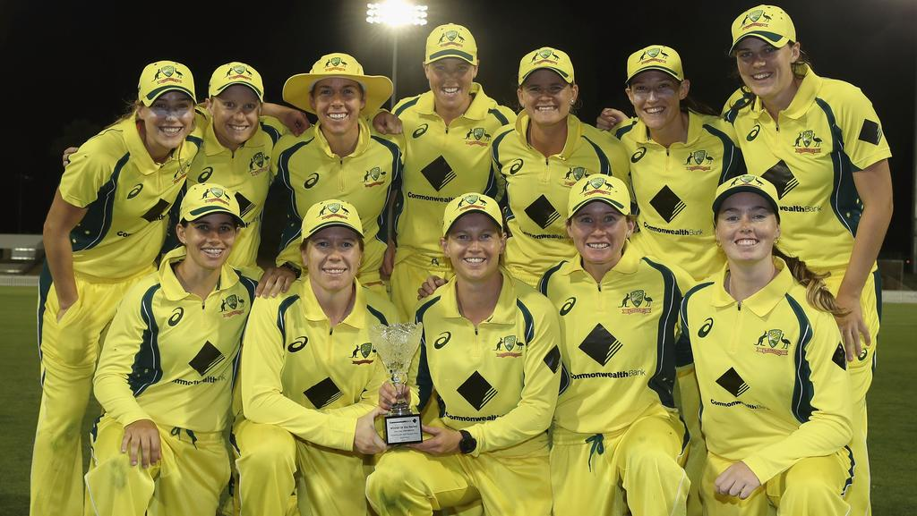 The Australian Southern Stars team pose with the trophy after their 4-0 series victory after winning the women's one day international match at Coffs Harbour.