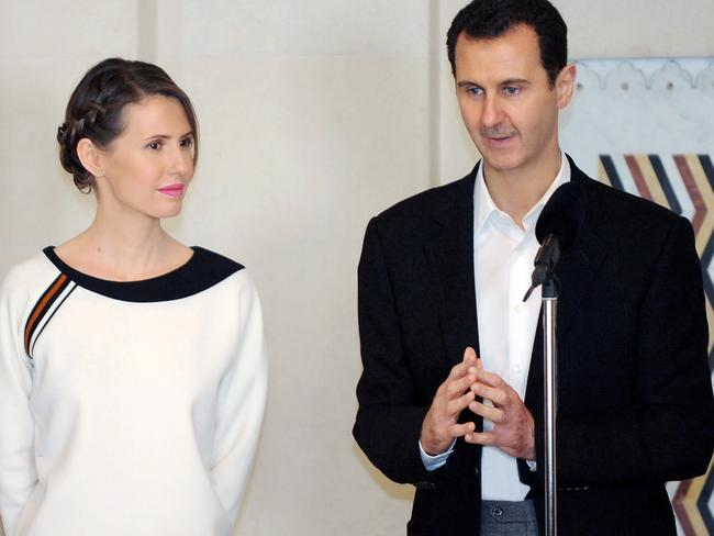 The US sees no role for Syrian President Bashar al-Assad (R) or his wife Asma. Picture: AFP