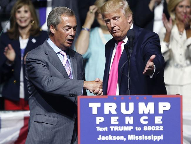 Donald Trump, right, welcomes pro-Brexit British politician Nigel Farage, to speak at oone of his campaign rallies. Picture: AP