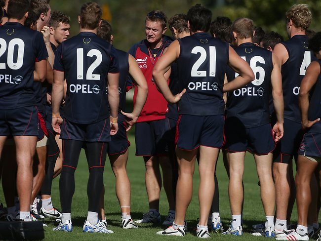 Mark Neeld coach of the Demons addresses his players during the Melbourne Football Club's AFL training session at Gosch's Paddock in Richmond, Melbourne, on Saturday 20th April, 2013. Picture: Dadswell Mark