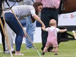 <p>It's clear it wont be long til the little prince is walking all by himself as Catherine, Duchess of Cambridge and Prince George of Cambridge attend the Royal Charity Polo. Picture: Getty</p>
