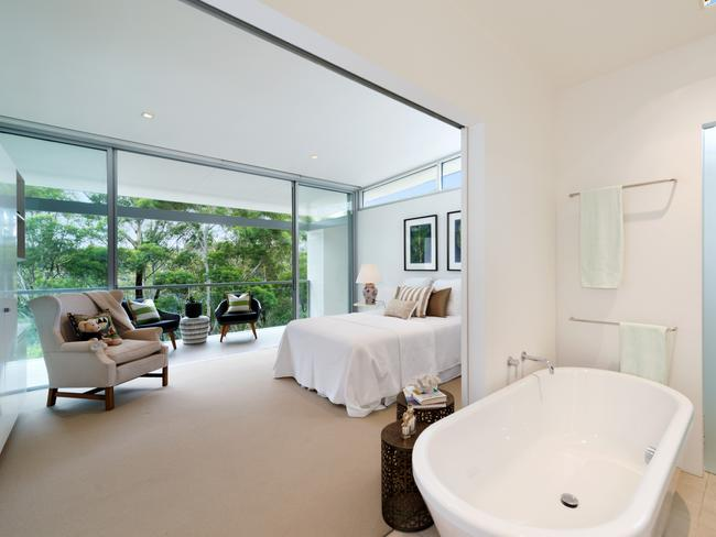 Upstairs is the main bedroom, which has its own balcony and a freestanding bathtub.