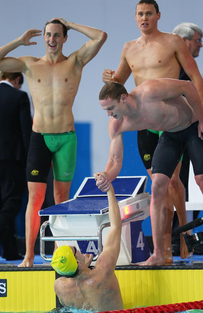 Thomas Fraser-Holmes of Australia is congratulated by his teammates after a brilliant final leg.