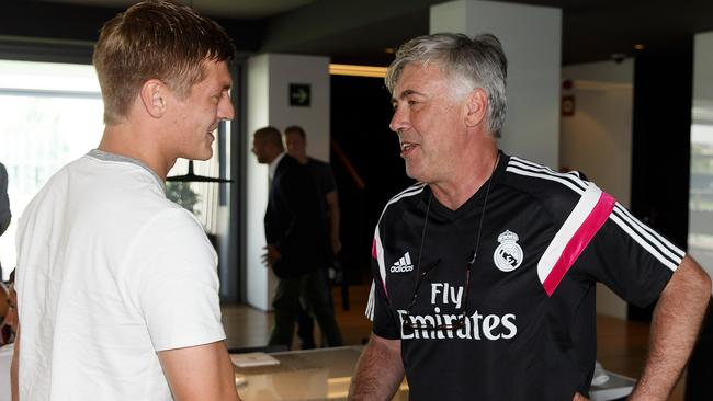Madrid coach Carlo Ancelotti shakes hands with another new signing, Toni Kroos.