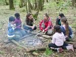 <p>Kate joins in with the story-telling around the fire. Picture: AFP</p>