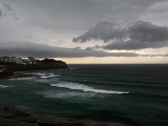 Dark clouds over Tamarama as thunderstorm casts a broody gloom over Sydney. Picture: John Appleyard