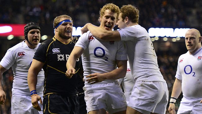England's centre Billy Twelvetrees celebrates scoring a try in the Six Nations win over Scotland at Twickenham Stadium. Picture: Adrian Dennis