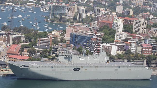Towering presence ... The Royal Australian Navy's biggest ever warship, the Landing Helicopter Dock (LHD) HMAS Canberra. Source: NewsCorp