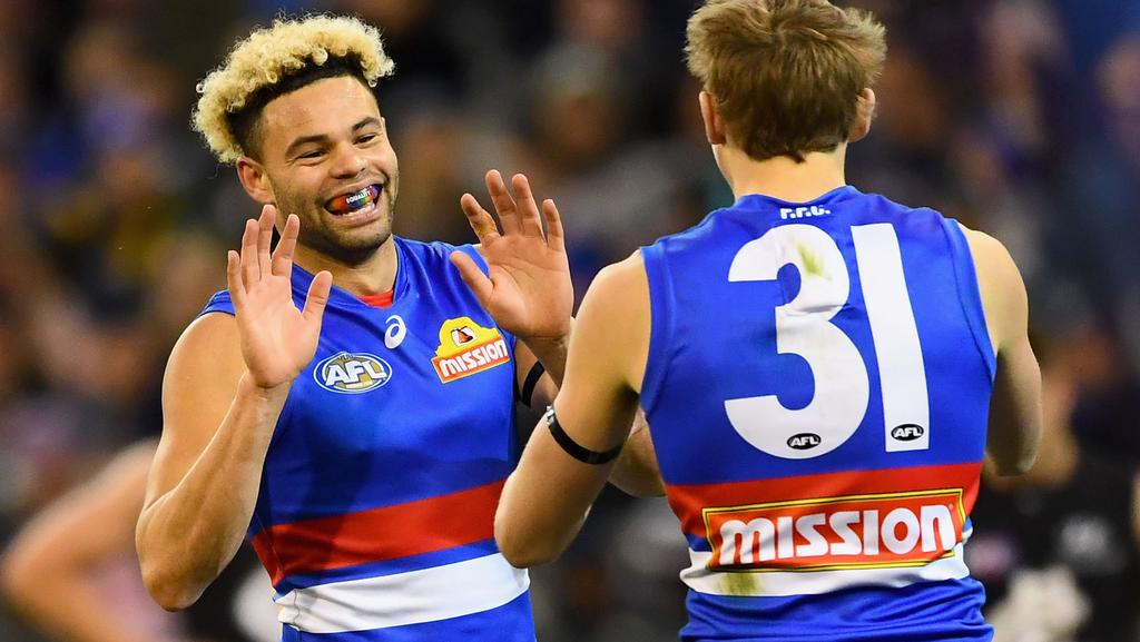 Jason Johannisen is congratulated by Bailey Dale after kicking a goal.