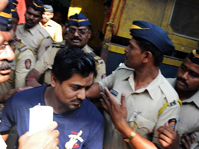 Death sentence ... double gang-rape convict Mohammed Salim Ansari is taken to court in Mumbai on April 4, 2014. Picture: indranil Mukherjee
