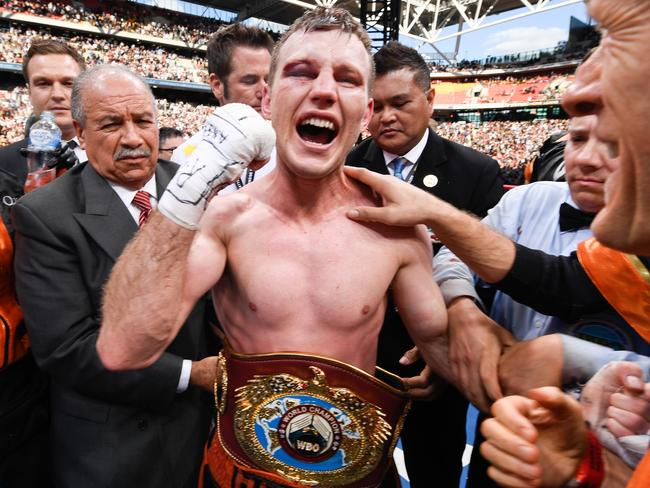 Jeff Horn (C) of Australia celebrates beating Manny Pacquiao.