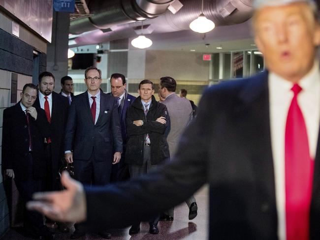 Donald Trump with Chief of Staff Reince Priebus, left; Jason Miller, a senior adviser, second from left; Boris Epshteyn, a spokesman for Trump, fourth from left, and Michael Flynn, Trump's nominee for National Security adviser, fifth from left, listen as Trump speaks. Picture: AP