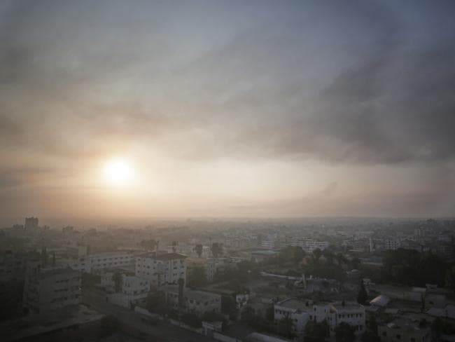 Dust and smoke rises over Gaza City ... Overnight Israeli strikes came after a day of heavy Hamas-Israeli fighting in which nine children were killed by a strike on a Gaza park where they were playing.