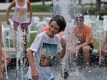 Spectators cool off in a fountain.