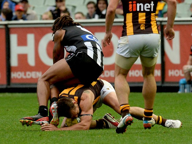 This incident involving Collingwood's Harry O'Brien and Hawthorn skipper Luke Hodge caused plenty of conjecture. Picture: Wayne Ludbey