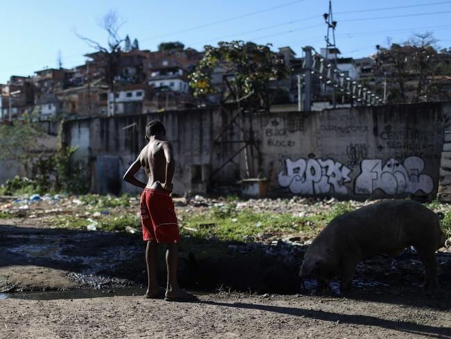 Rio is one of the world's most popular tourist destinations but it also has many favelas, Portuguese for slum, which house communities of low-income, working-class Brazilians. Photo: Mario Tama/Getty Images