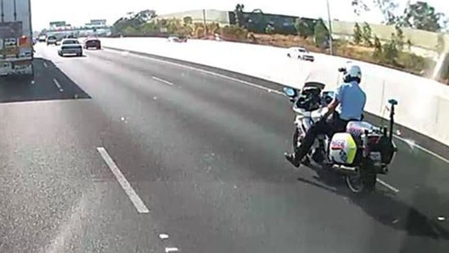 Motorcycle cop with foot off peg