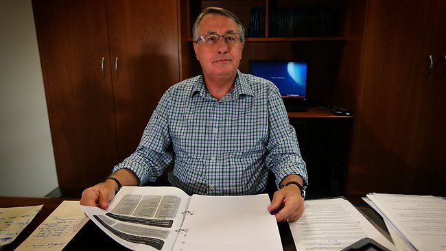 "Treasurer Wayne Swan at work in his ""other"" office in Treasury ahead of this week's budget."