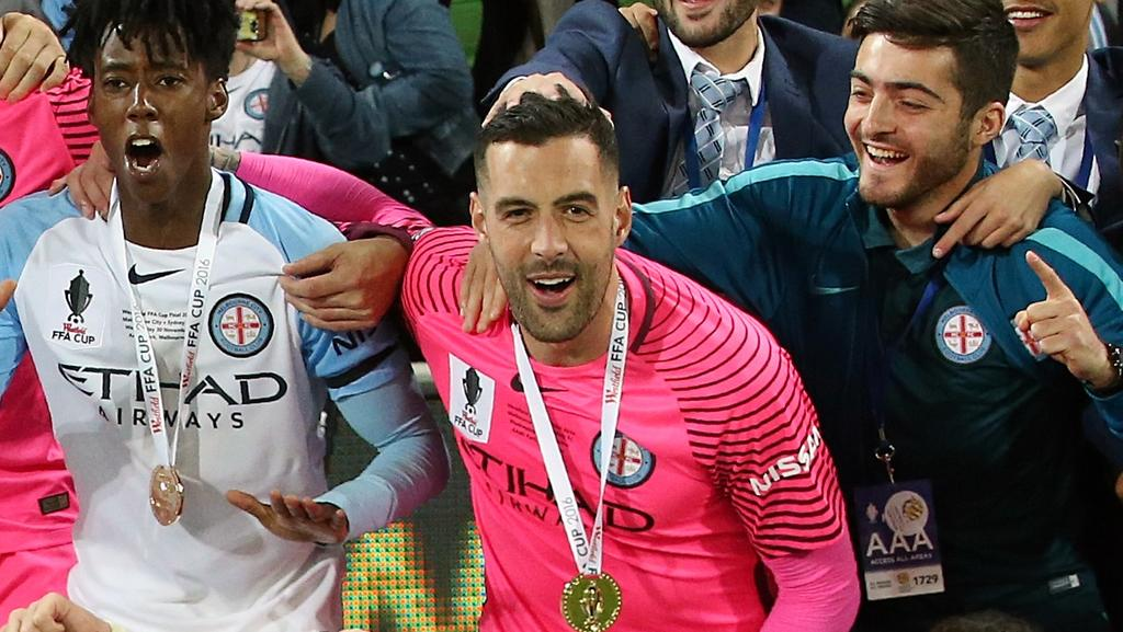 Dean Bouzanis celebrates with his City teammates after winning the FFA Cup. Picture: Wayne Ludbey