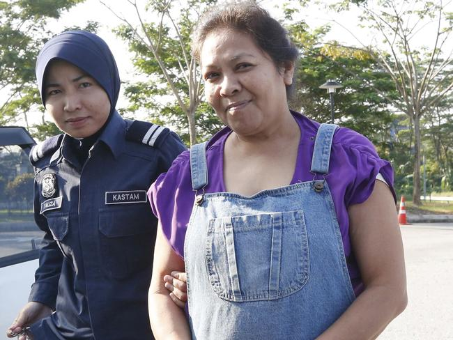 Exposto arrives at the magistrates court in Sepang, near Kuala Lumpur, January 23, 2015. Picture: Olivia Harris/Reuters